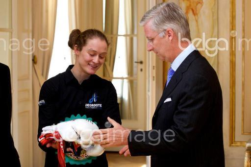 20140428 - BRUSSELS, BELGIUM: Belgian Delfine Persoon hasa gift for King Philippe - Filip of Belgium pictured during as King receives the winner of the world title of the WBC female lightweight, Monday 28 April 2014 at Royal Palace in Brussels. BELGA PHOTO KURT DESPLENTER
